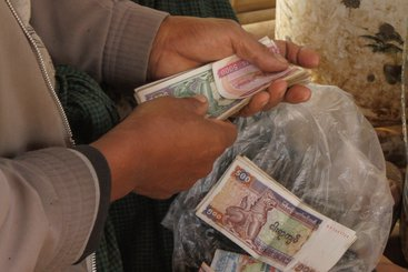 The Government of Myanmar allowing for a managed float of the kyat, legalising the use/exchange of foreign currencies