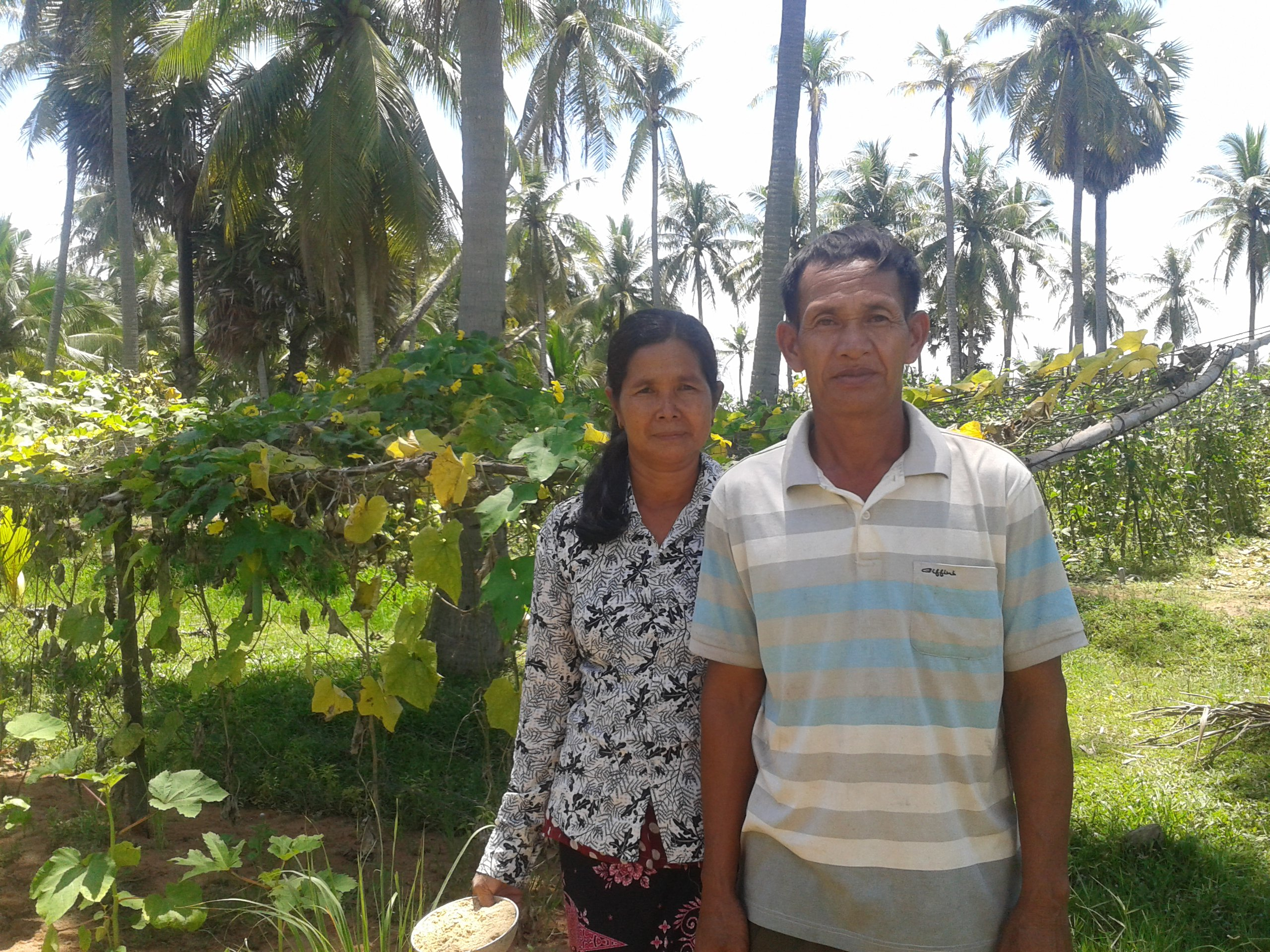 Wife and Husband in their vegetable garden, rural Cambodia, 2017. Photo: Sharada Keats