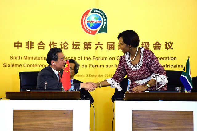 Minister of International Relations and Cooperation, Maite Nkoana-Mashabane, shakes hands with Wang Yi, Minister of Foreign Affairs of the People's Republic of China during the Opening Ceremony of the 6th Ministerial Meeting of the Forum on China-Afr