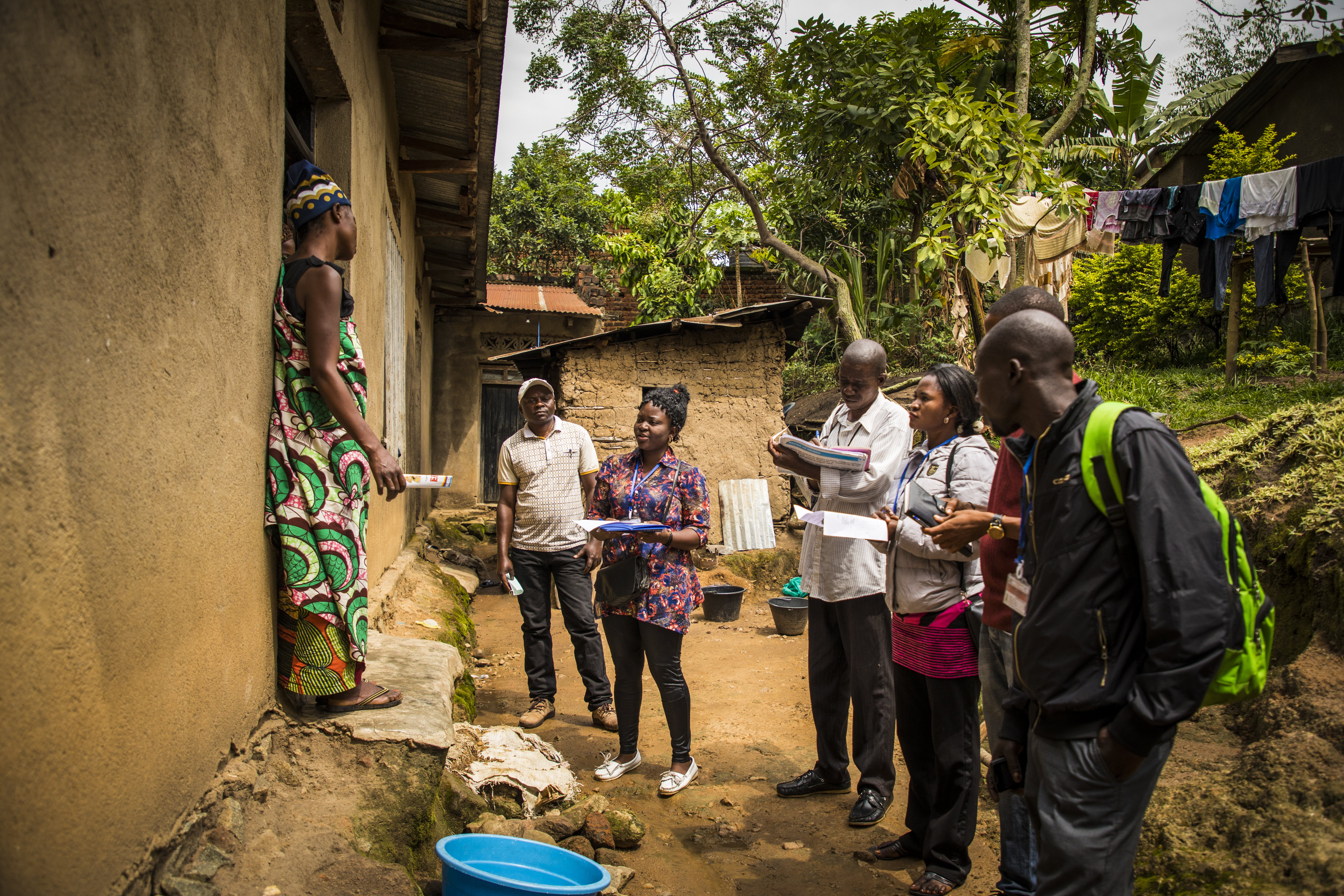 Community representatives visit a family on the outskirts of Beni, DRC to raise awareness about Ebola