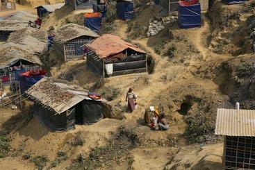 Rohingya women pump water In Balukhali refugee camp, Chittagong district, Bangladesh