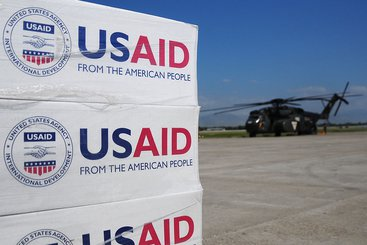 Pallets of food, water and supplies staged to be delivered. Photo: USAID (CC BY-SA 2.0)