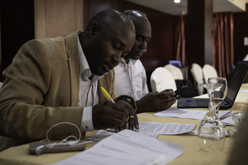 Members of the Africa Mini-Grids Community of Practice from Cote d'Ivoire prepare a session on their mini-grids country context at a workshop in Abuja, Nigeria. Photo: Geraint Hill, 2018