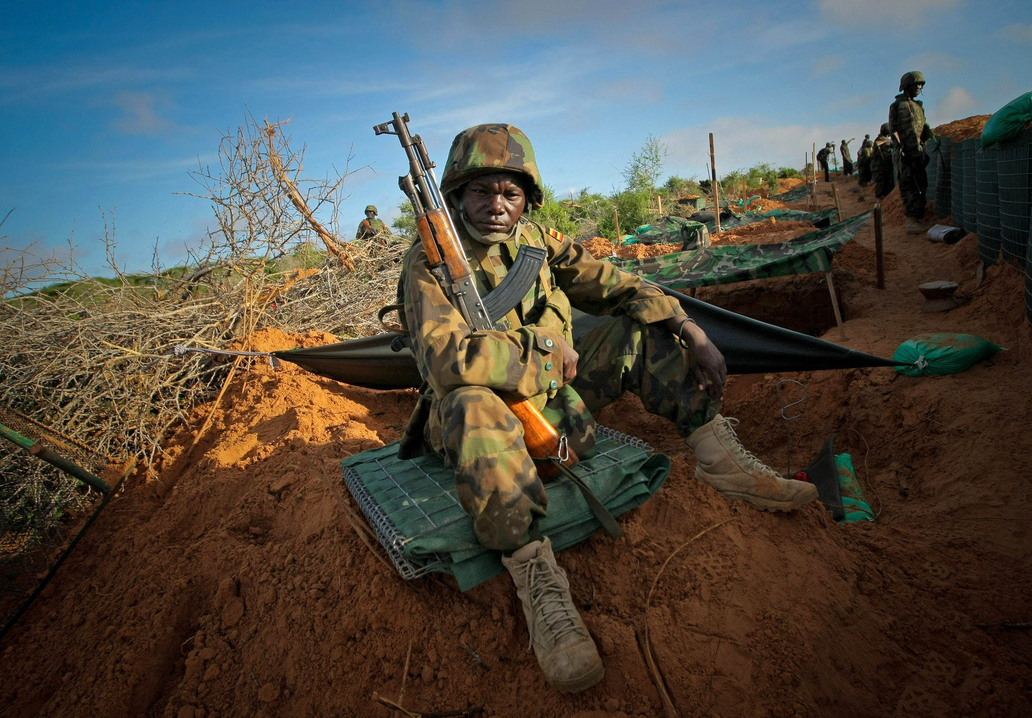 Ugandan soldiers serving with the African Union Mission in Somalia (AMISOM) man the frontline near Mogadishu, 2012 © AMISOM