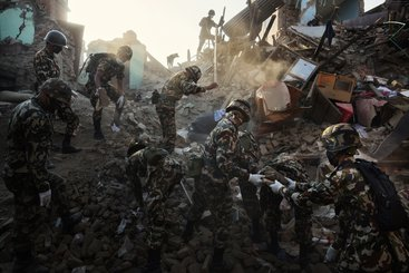 Nepalese Army soldiers search through the rubble of homes destroyed in the April 25th earthquake, in Shanku.   On 25 April 2015 a powerful earthquake of 7.8 magnitude struck Nepal, causing widespread destruction and killing approximately 8,452 people and injuring more than 19,000. Another powerful earthquake hit the country on May 12th, killing hundreds and injuring more than 2,000 (May 14th estimate).