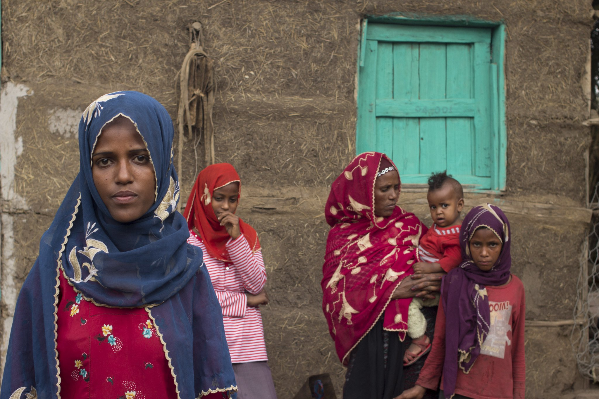 A girl and the family she supported with her earnings in Saudi Arabia following an early marriage. The family now live in Hara, Amhara Region, Ethiopia