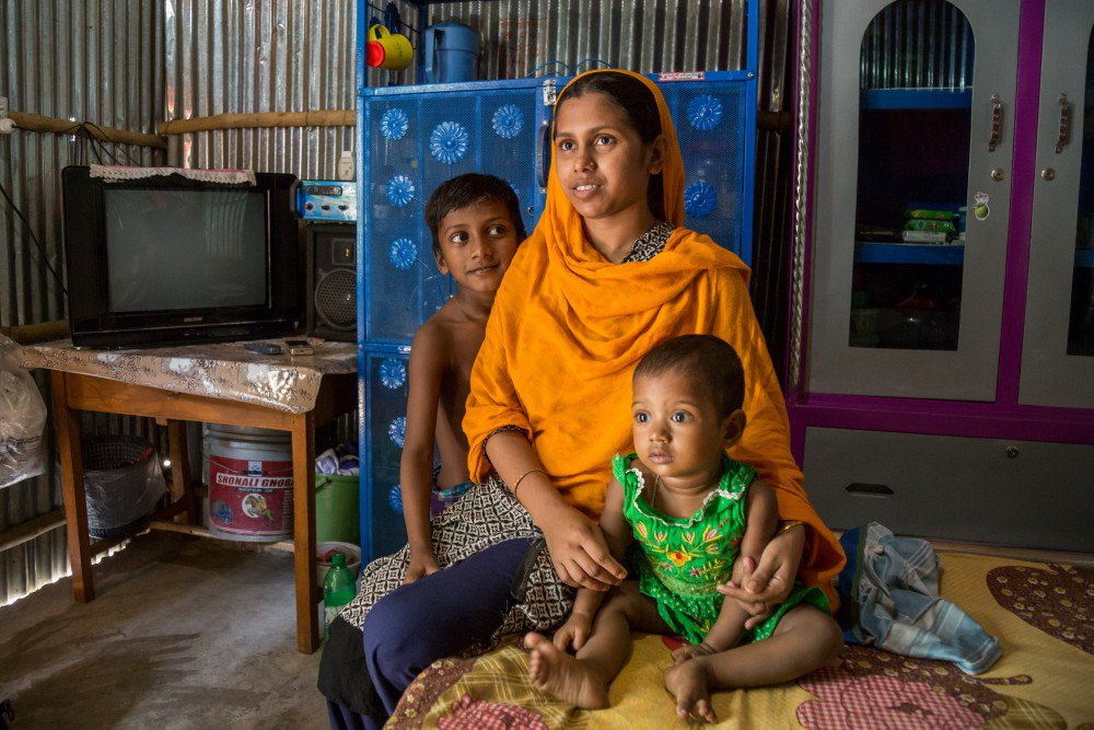 Adolescent married girl with her two children in Dhaka, Bangladesh