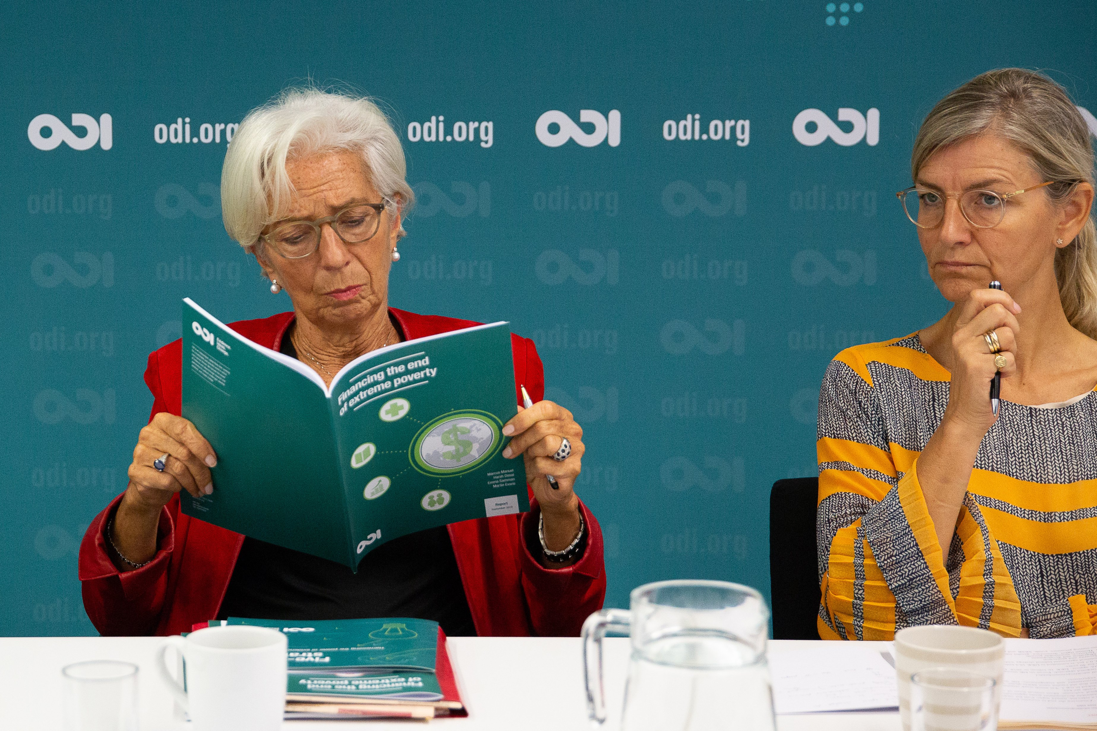 Christine Lagarde, Managing Director of the IMF, reading ODI report at a roundtable event with Ulla Tørnæs, Danish Minister for Development Cooperation