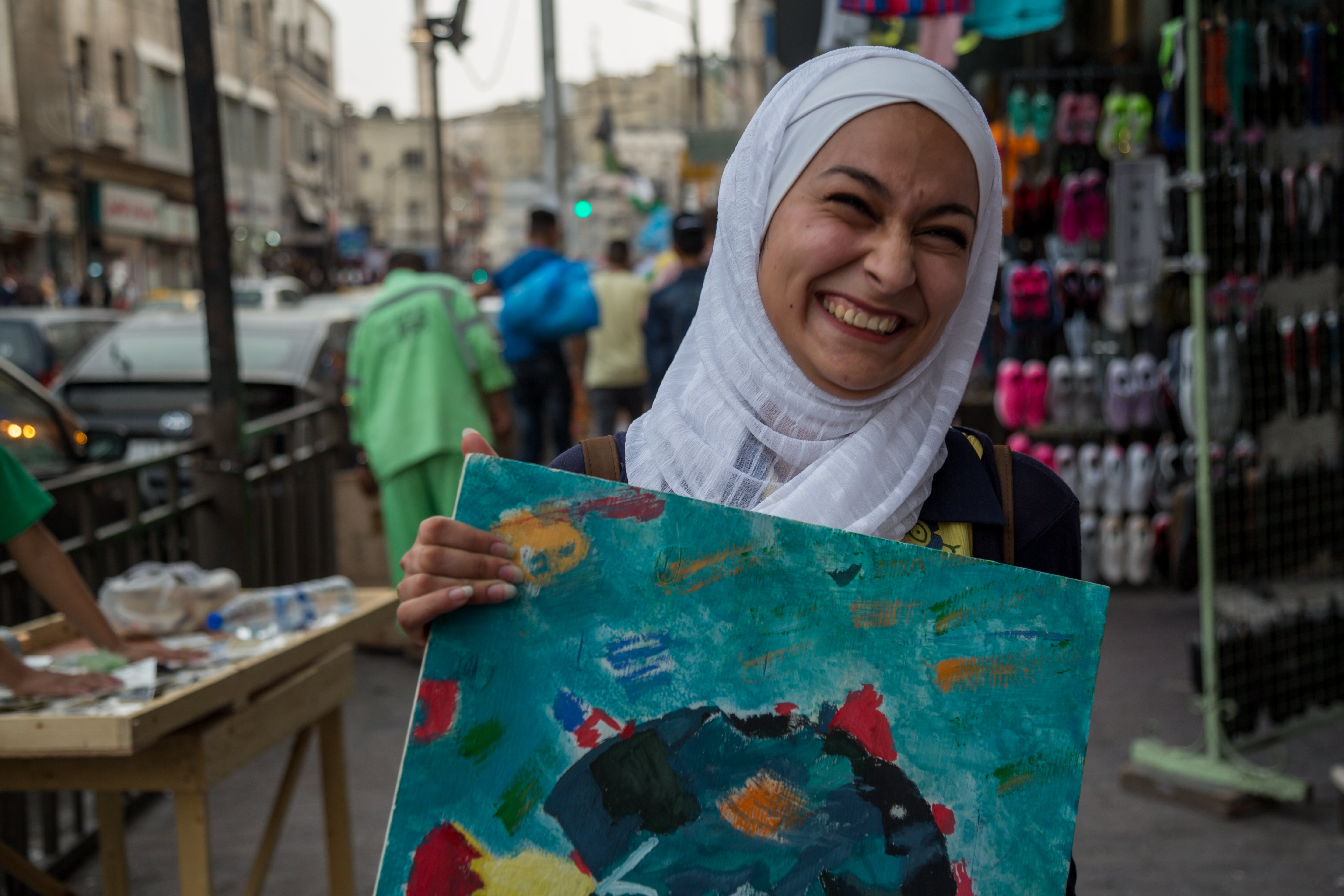 17-year-old Jordanian girl with one of her paintings