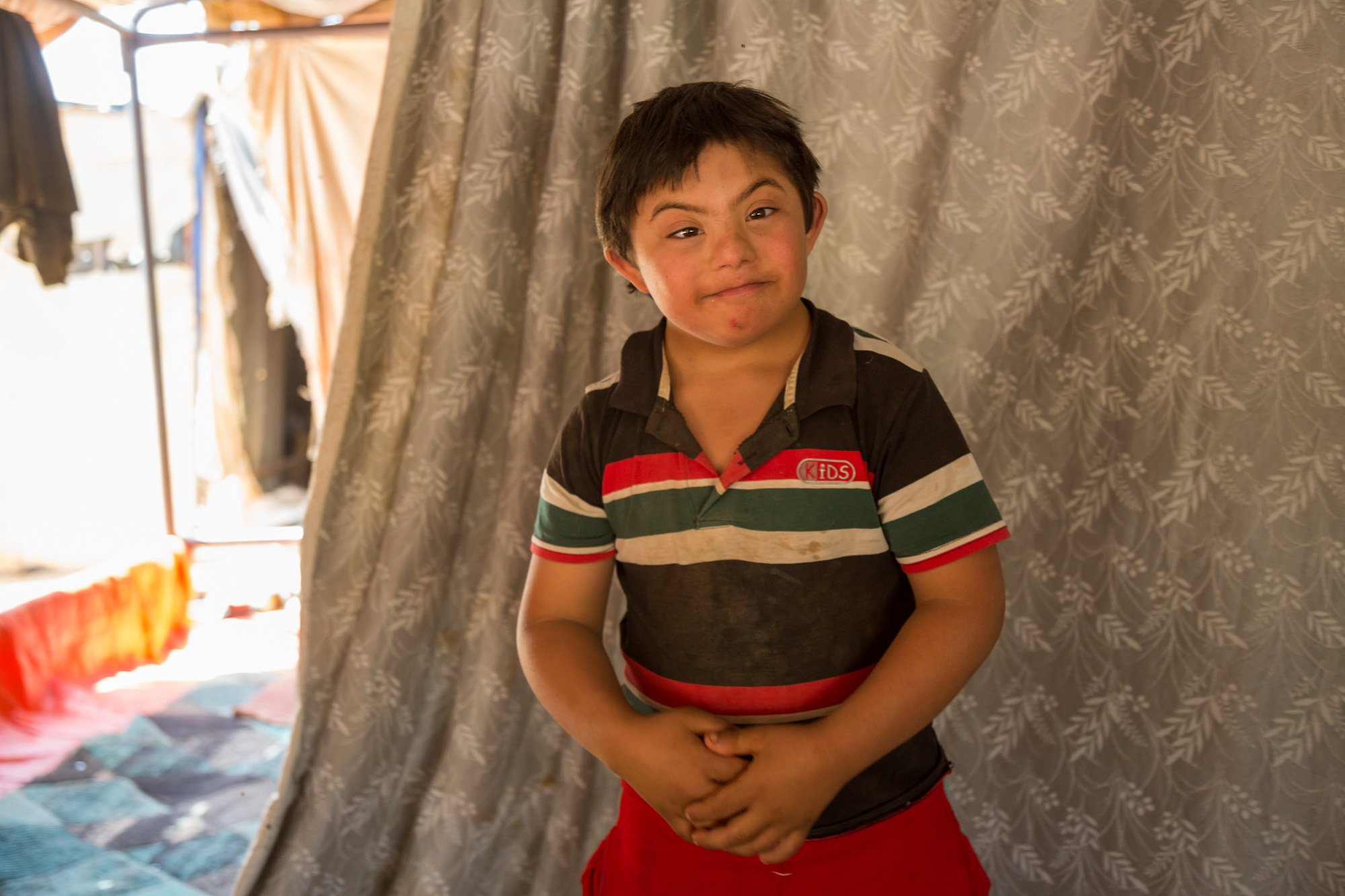 A 10-year-old Syrian refugee in Jordan with down syndrome