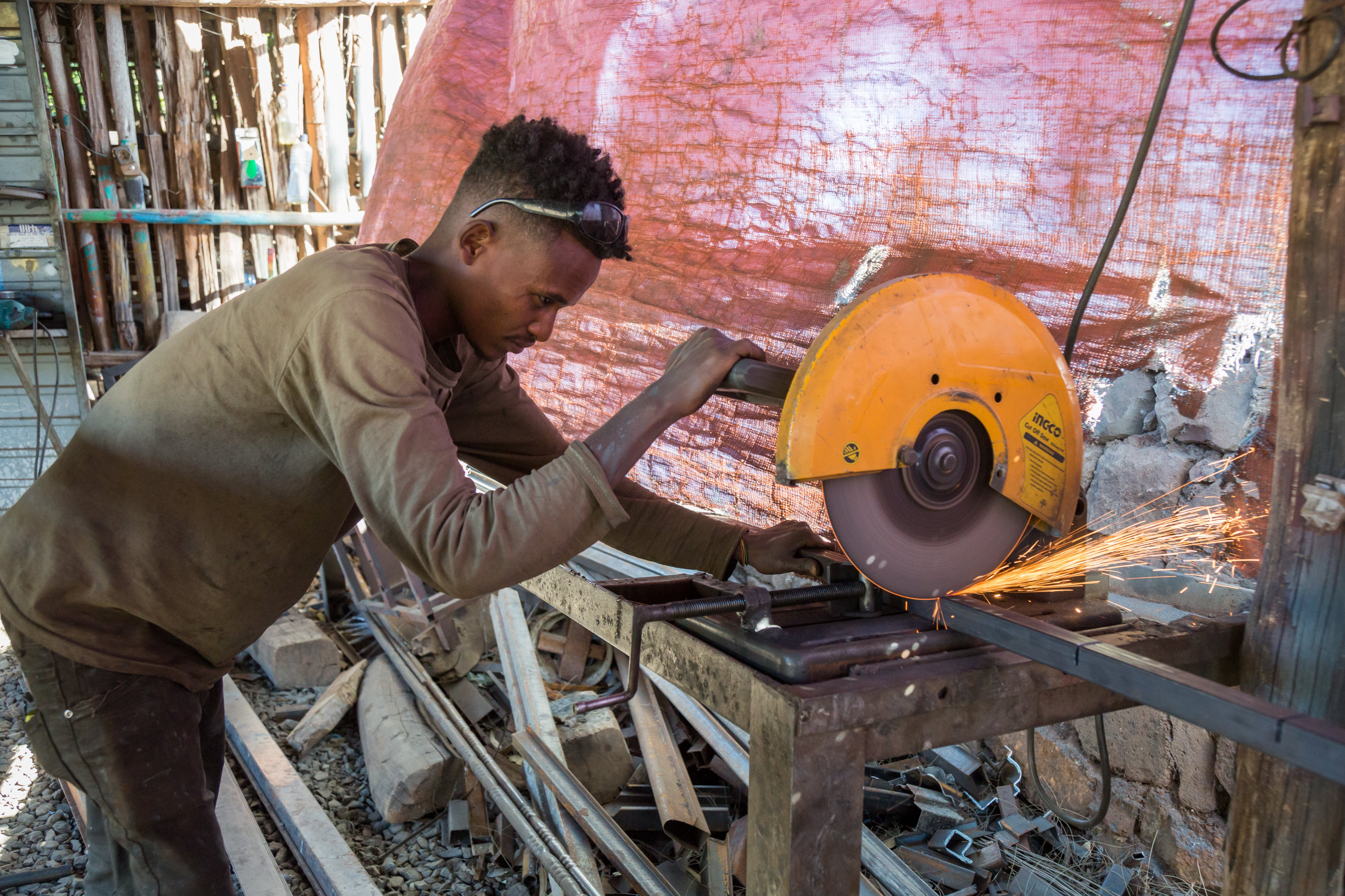 An adolescent boy working as a metal worker in Ethiopia