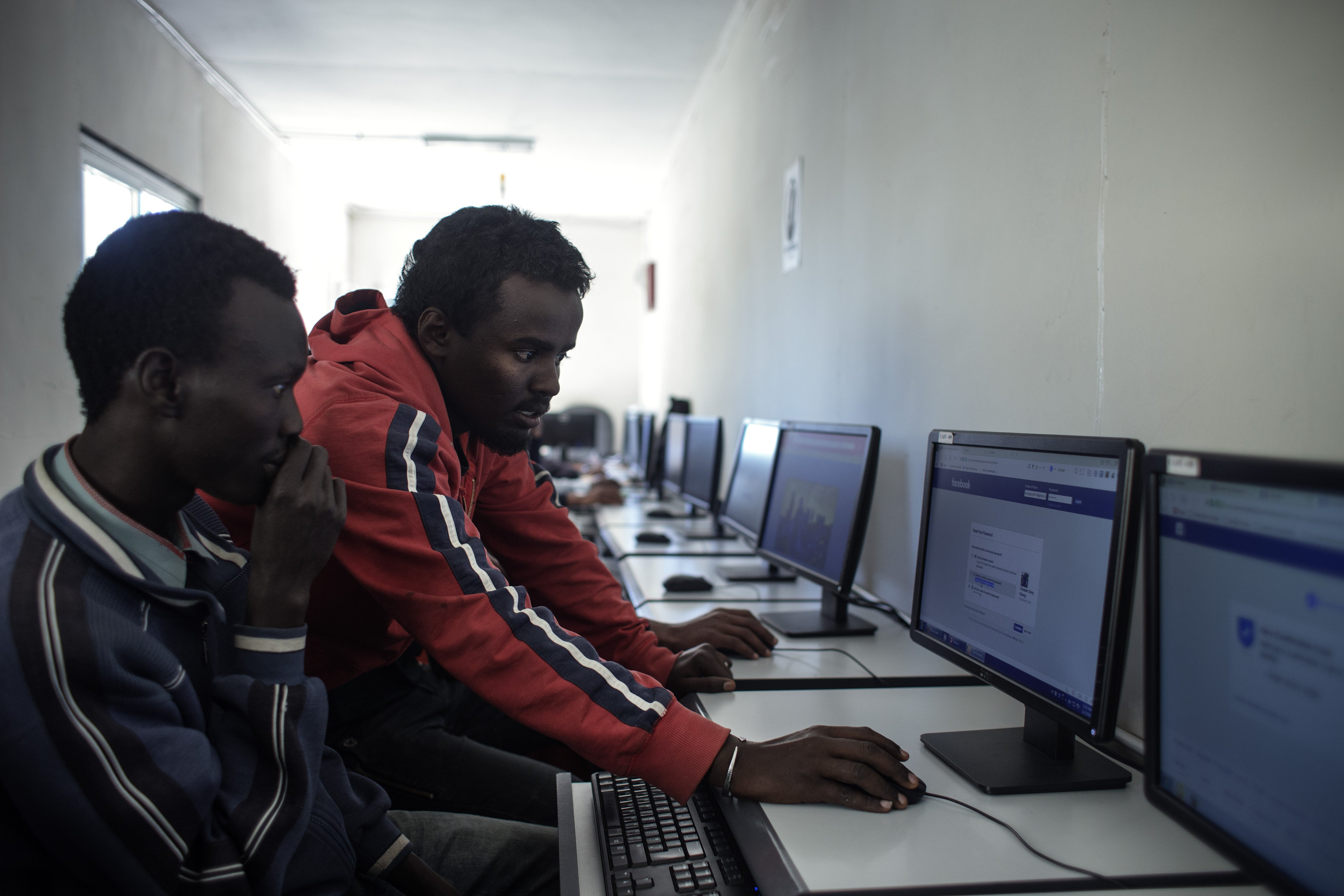 Yesuf working in the internet café at the JRS centre in Addis Ababa