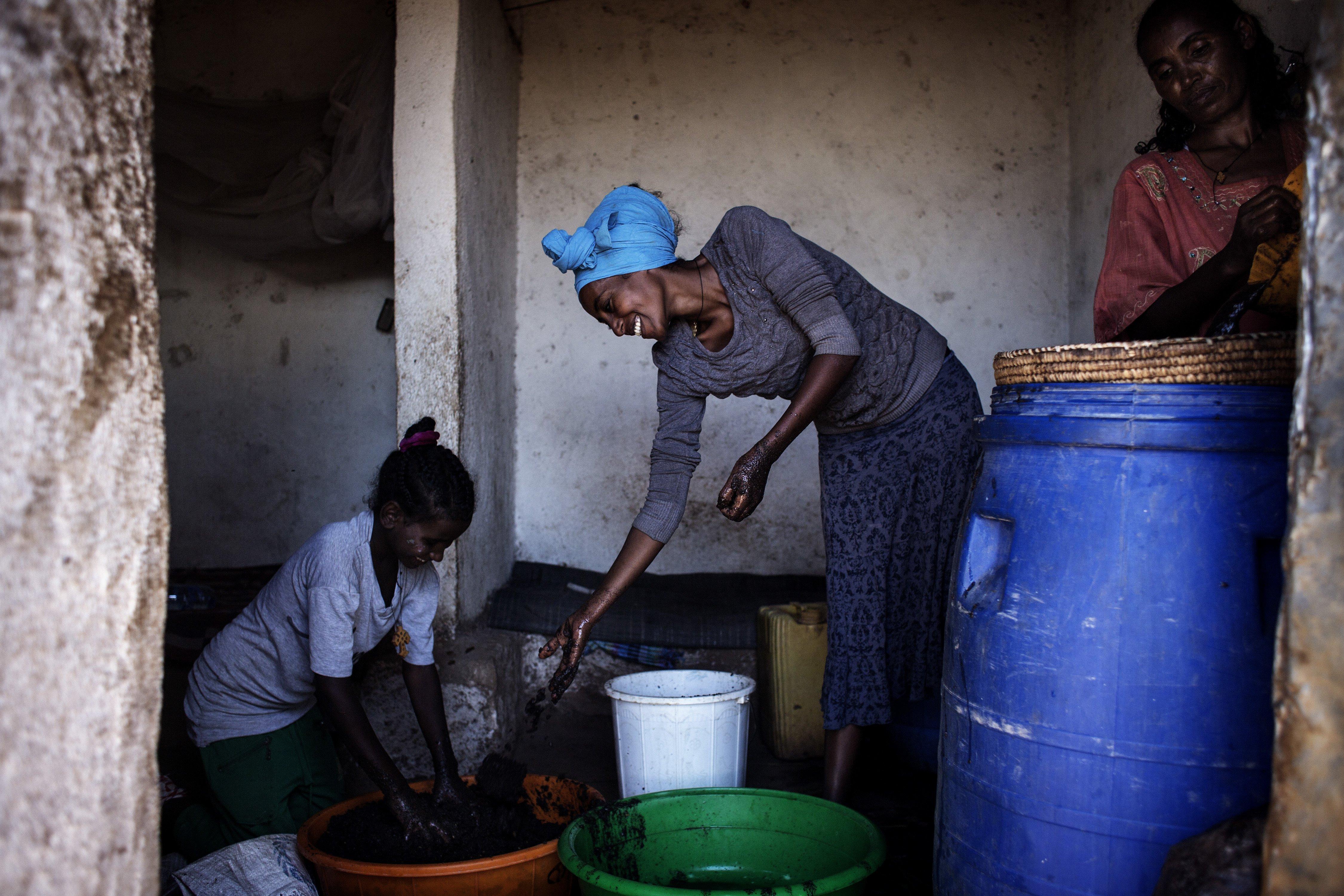 Refugees making beer in Adi Harush refugee camp, Ethiopia