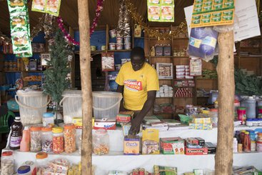 South Sudanese refugee and entrepreneur, Jacob, at the shop he owns in the market in Nyumanzi refugee settlement, Uganda