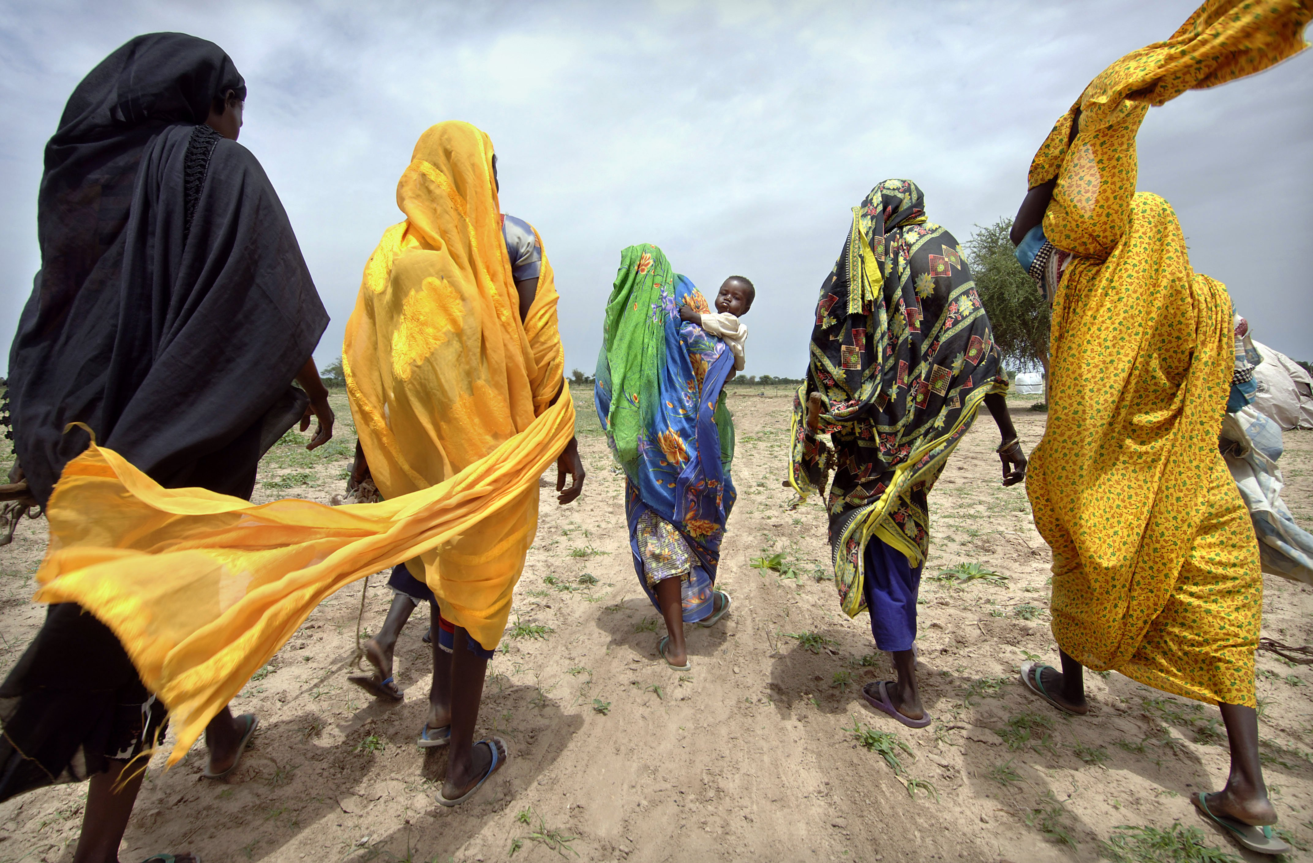 Women leaving a camp for internally displaced persons to collect firewood, Gereida, South Darfur, Sudan