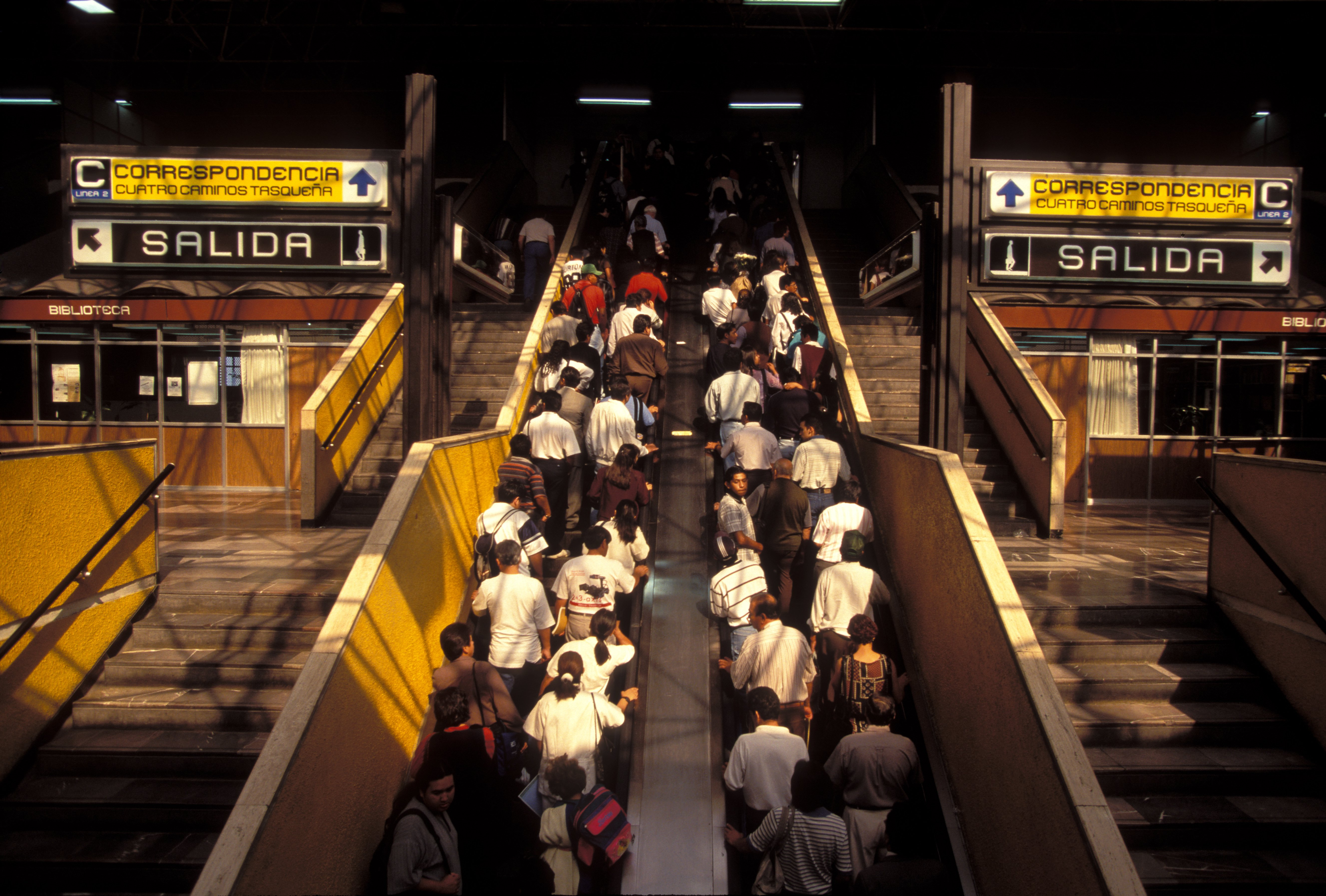 Passengers exit a metro station in Mexico City