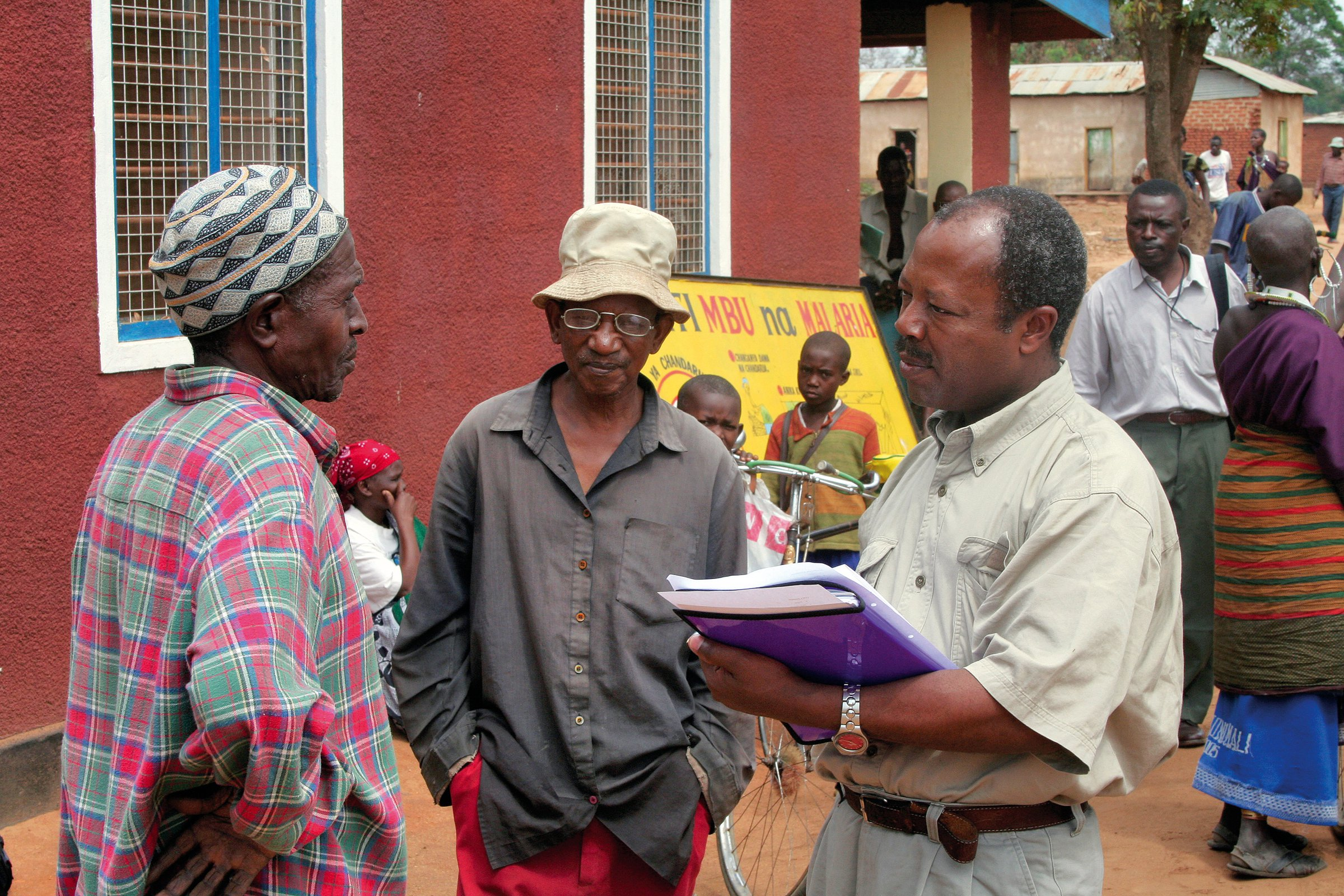 Community Eye Health worker interviewing patient before surgery in Tanzania