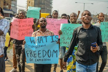 Group of men protest against the Anti-Social Media bill brought to the Nigerian Parliament, in Lagos, Nigeria, November 2019.