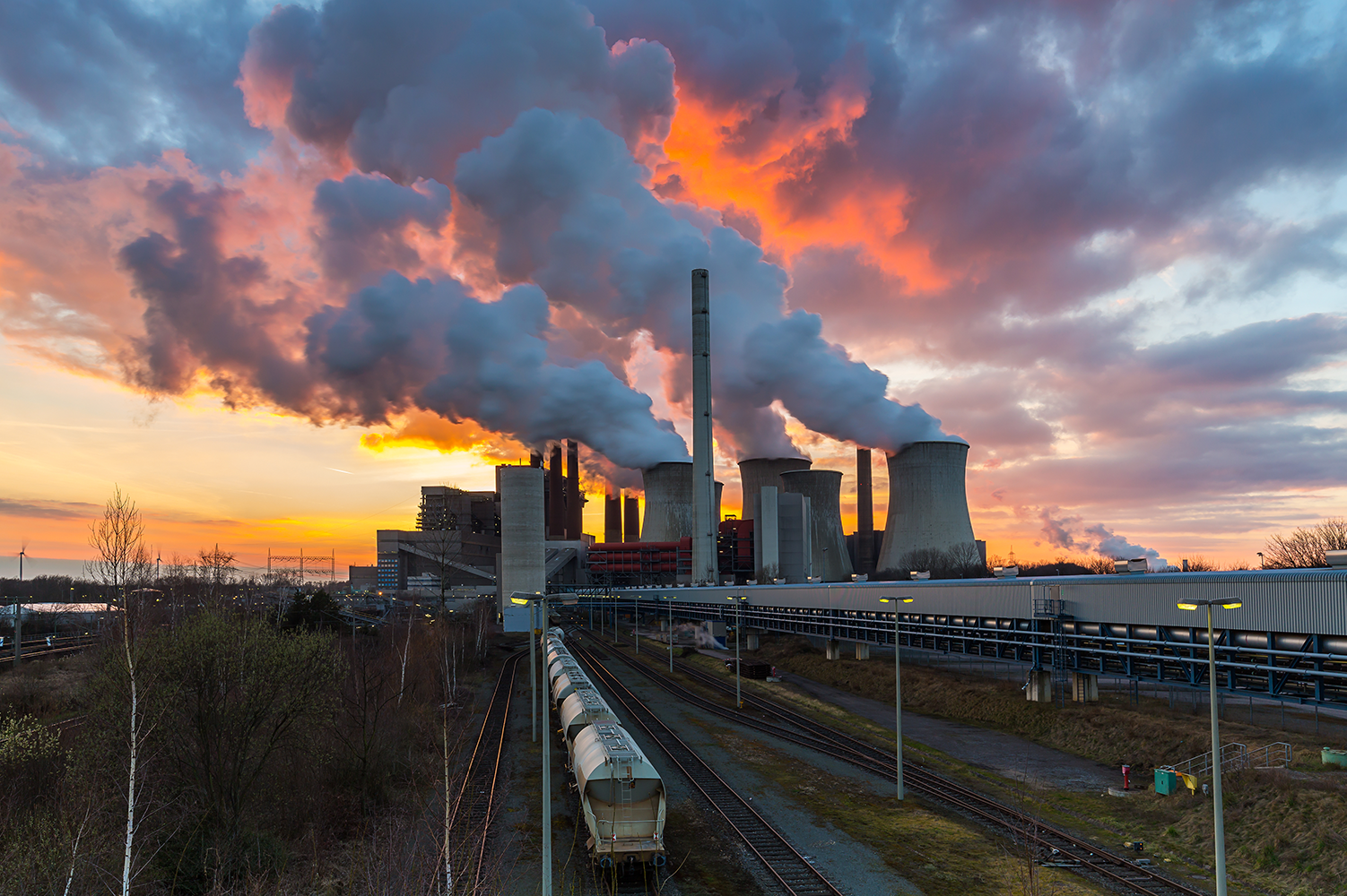Lignite Power Plant at sunset with cloudy sky in Neurath, Germany.