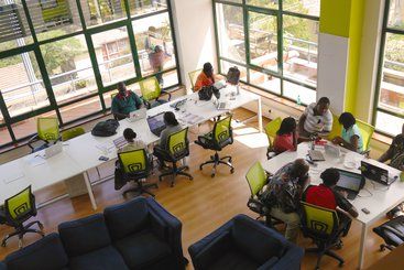 Nairobi, Kenya, October 2013: Co-workers at the iHub Nairobi, a working space for technology entrepreneurs.