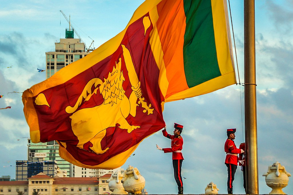 Sri Lankan flag being lowered down at the end of the day in Colombo